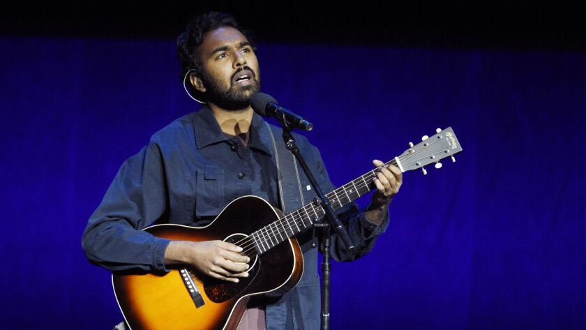 "Himesh Patel, star of the upcoming film ""Yesterday,"" performs the Beatles' song of the same name during the Universal Pictures presentation at CinemaCon in Las Vegas."