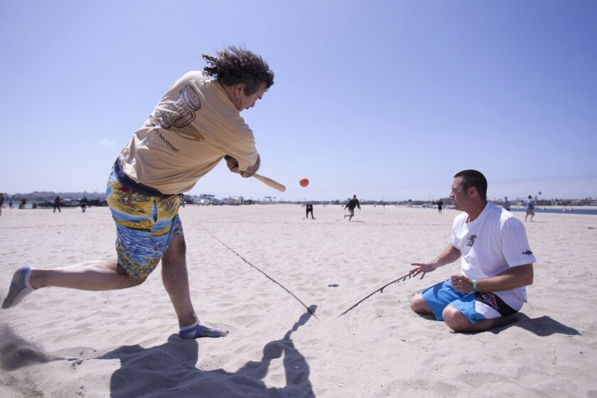 Paco Fitzurka, 64, and his teammate Shane West, 43, compete in a recent tournament for Over the Line Champions of all brackets on Fiesta Island.