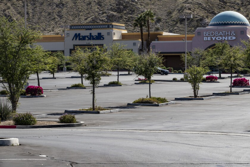 Parking lots are empty as stores are closed during the coronavirus pandemic in Rancho Mirage.