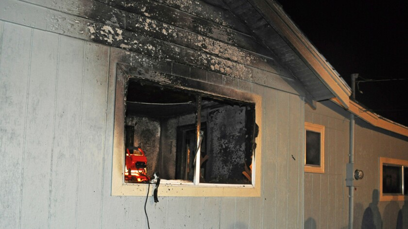 This photo provided by the Spokane, Wash., Fire Department shows the home where a toddler and his dog died in a fire.