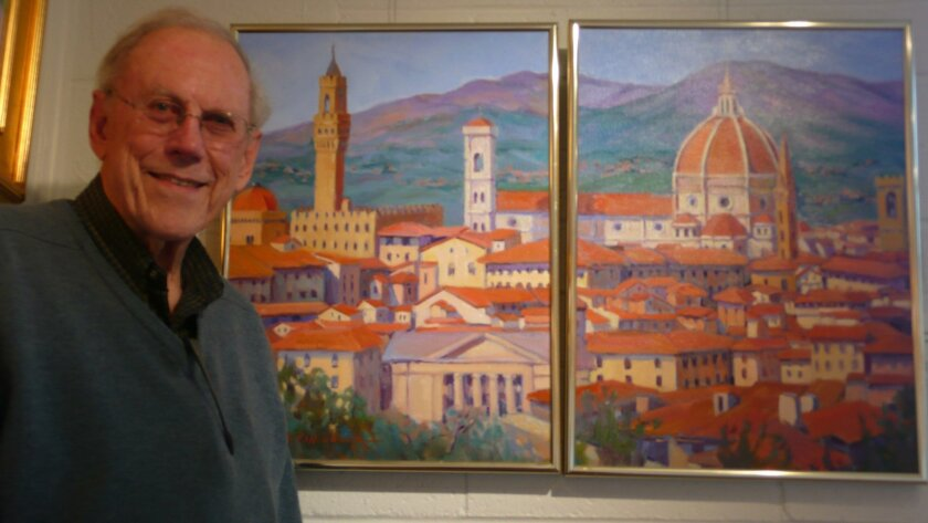 Robert Riffenburg with one of his late wife's paintings on display at the La Jolla Art Association.