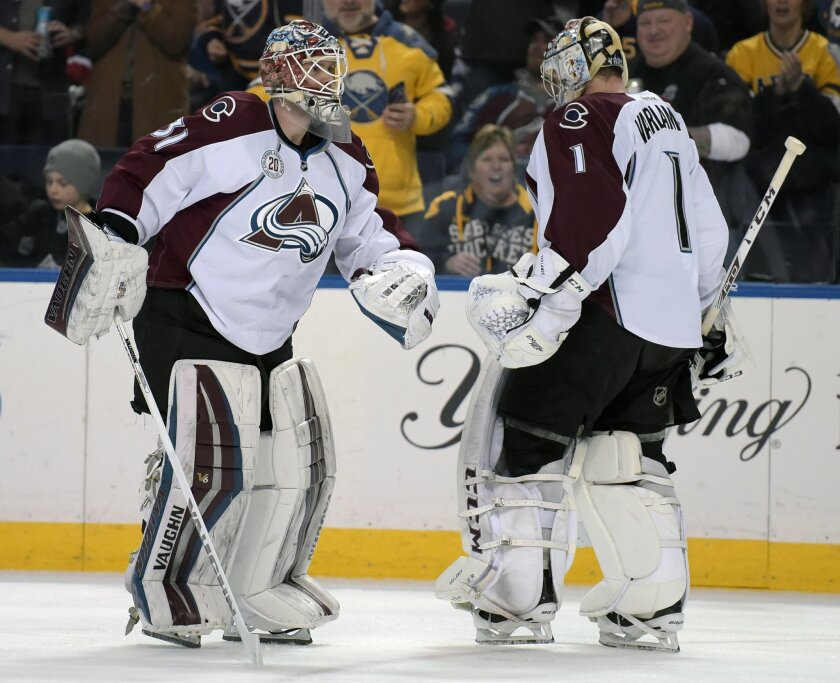 Colorado Avalanche Calvin Pickard (31) replaces goaltender Semyon Varlamov (1) after Varlamov let up two goals on two shots during the first period of an NHL hockey game against the Buffalo Sabres, Sunday, Feb. 14, 2016, in Buffalo, N.Y. (AP Photo/Gary Wiepert)