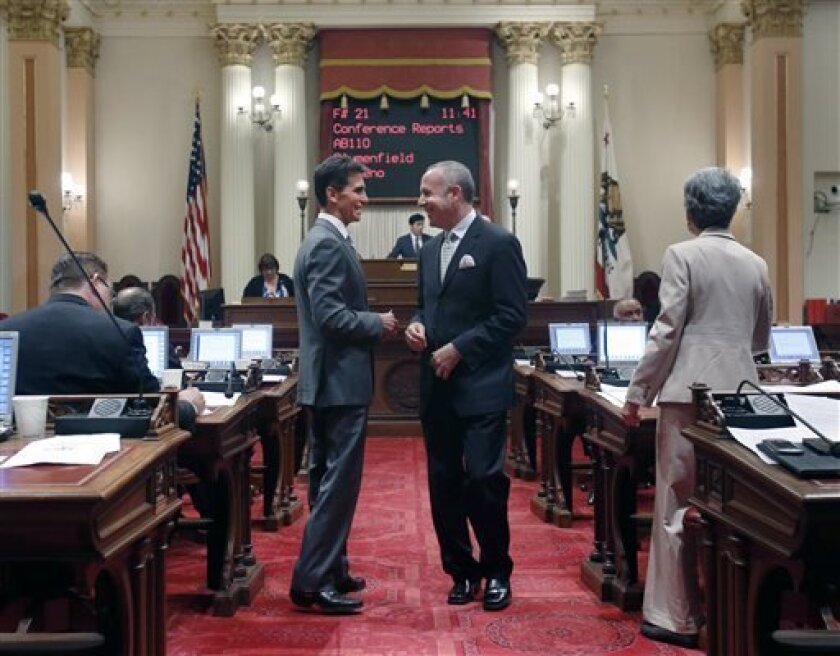 State Senator Mark Leno, D-San Francisco, chair of the Senate Budget committee, left, smiles as he talks with Senate President Pro Tem Darrell Steinberg, D-Sacramento, as the Senate debated the state budget, Friday, June 14, 2013 in Sacramento, Calif.  By a 28-10 party-line vote the Senate approved