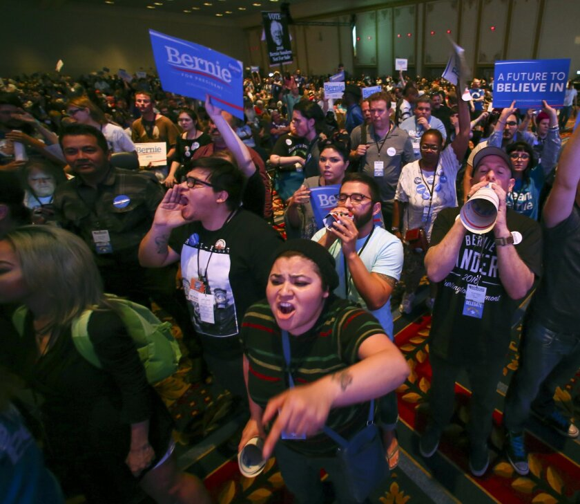 In a Saturday, May 14, 2016 photo, supporters of Democratic presidential candidate Bernie Sanders react as U.S. Sen. Barbara Boxer, D-Calif., speaks during the Nevada State Democratic Party's 2016 State Convention at the Paris hotel-casino in Las Vegas. The Nevada Democratic Convention turned into