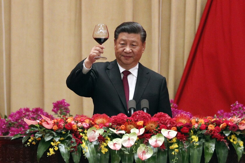 Chinese President Xi Jinping makes a toast after delivering his speech at a dinner marking the 70th anniversary of the founding of the People's Republic of China.