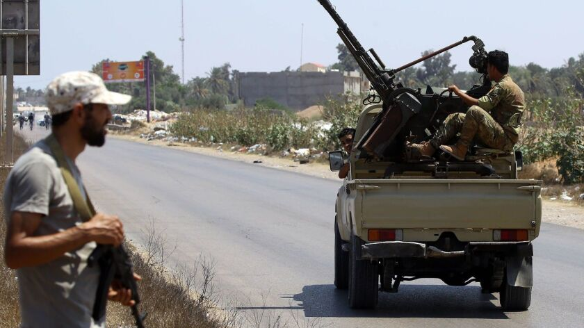 Libyan security forces patrol near the site of an attack on a checkpoint in the city of Zliten, east of Tripoli.