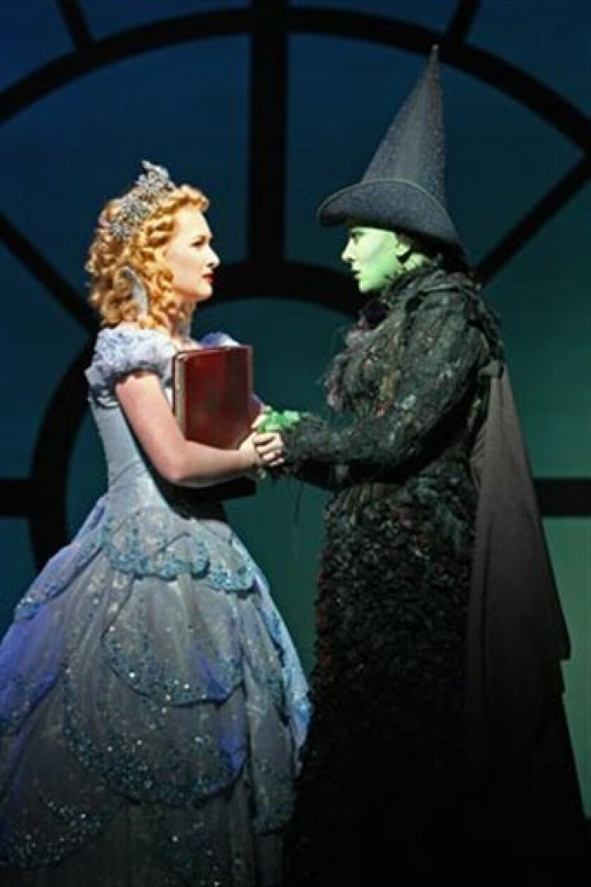 """In this theater publicity image released by The Hartman Group, Erin Mackey portrays Glinda, left, and Dee Roscioli portrays Elphaba in a scene from the production of the musical, """"Wicked."""" (AP Photo/The Hartman Group, Joan Marcus)"""