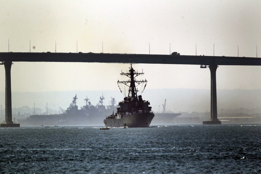 The Decatur passed under the Coronado bridge on her way out to sea.