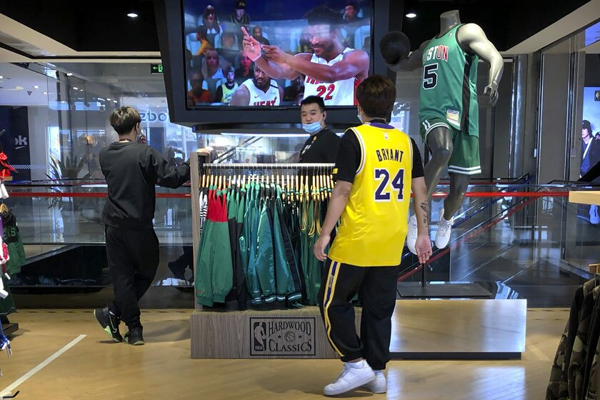 Employees watch a live broadcast of Game 5 of the NBA Finals at an NBA store in Beijing on Saturday.