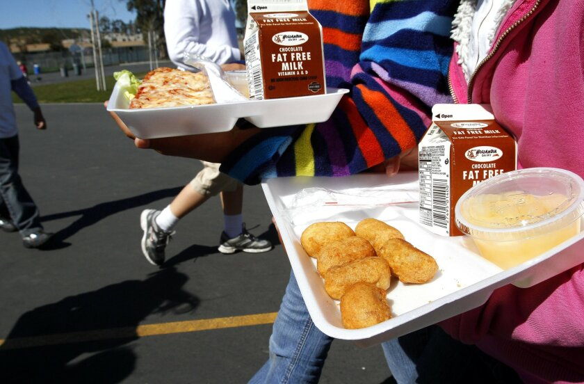 Students in San Marcos carry their lunches on styrofoam trays in 2013.