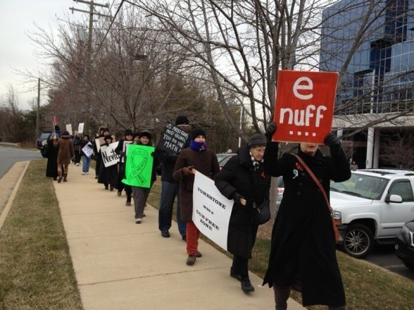 """Protesters demonstrate outside of the NRA headquarters during a """"Day of Action"""" to promote gun control proposals."""