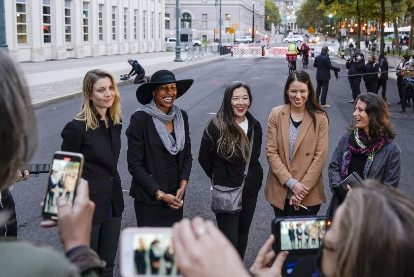 FILE — In this Oct. 27. 2020 file photo, Nicki Clyne, left, Michelle Hatchette, second from left, Linda Chung, center, and Dr. Danielle Roberts, right, speak outside Brooklyn federal court following the sentencing hearing for self-improvement guru Keith Raniere, in New York. New York health officials have revoked the medical license of Roberts, Friday, Oct. 1, 2021, who branded 17 women with the initials of the cult-like group's leader, Keith Raniere. (AP Photo/Frank Franklin II, File)