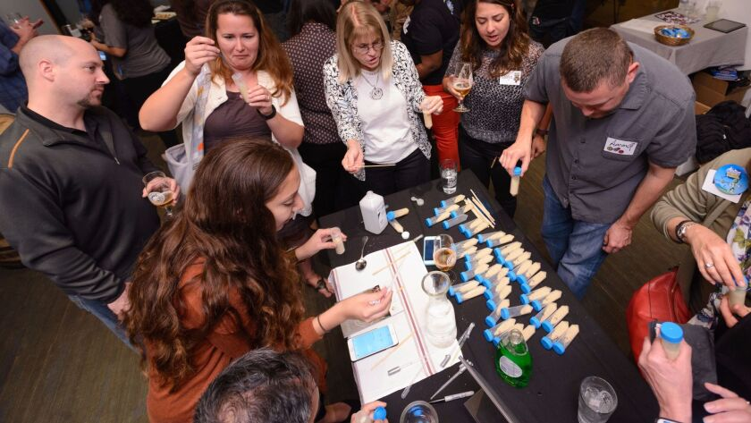 Guests extract DNA using wheatgerm at the Think Drink Science Series 2016 held at Ballast Point in Miramar.
