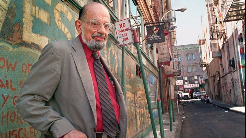 Poet Allen Ginsberg stands in Jack Kerouac Alley next to City Lights Bookstore in San Francisco's North Beach district in September 1994.