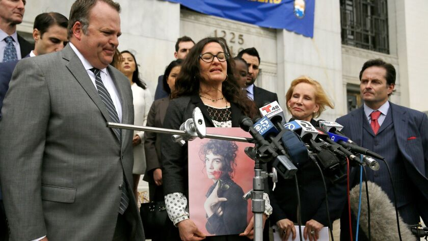 Leisa Askew holds a photograph of her daughter, Cash Askew, who died in the Ghost Ship warehouse fire. Askew and attorneys spoke during a news conference in Oakland on Tuesday.