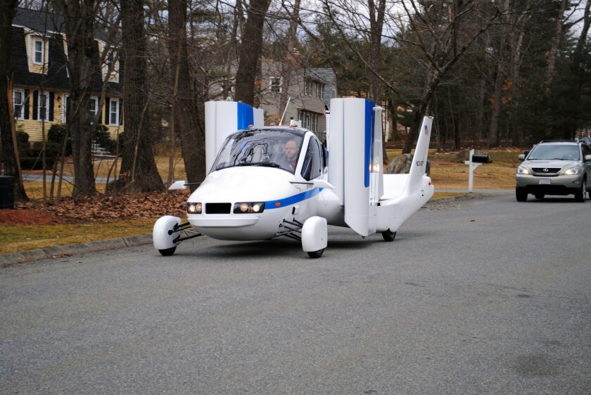 """Terrafugia Inc.'s prototype flying car, dubbed the Transition, travels down a street with its wings folded. Crowdfunding is attractive to start-ups such as Terrafugia, says the company's co-founder, Carl Dietrich. """"For publicly traded companies, individual investors don't have the ability to influence the success and failure of a company,"""" Dietrich said. """"But for small start-ups, they absolutely have the ability to influence success and failure. That's exciting and something we haven't seen before."""""""