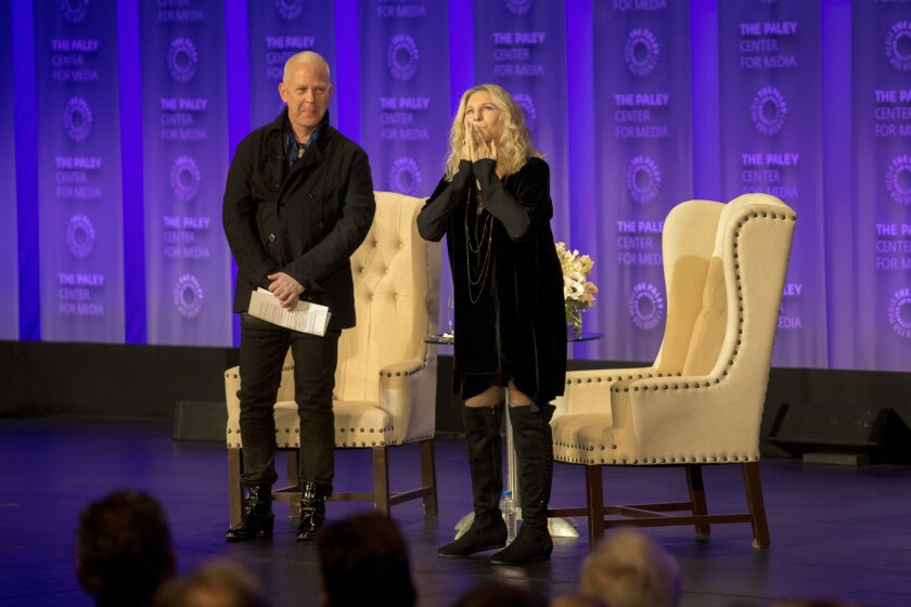 Barbra Streisand with host Ryan Murphy on the first night of PaleyFest 2018. This year's festival has been postponed over concerns about the spread of the coronavirus.