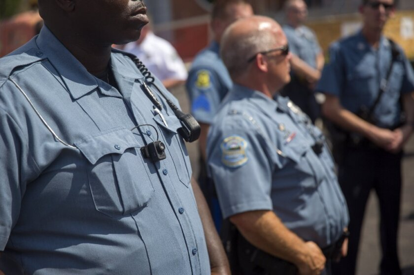 Members of the Ferguson Police department during a rally in Ferguson, Mo.