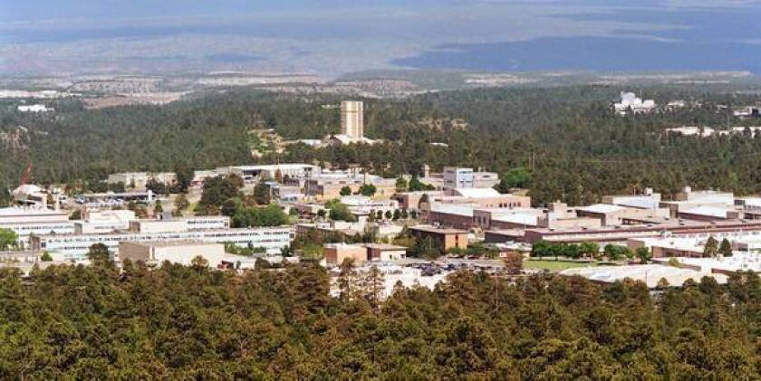The Los Alamos National Laboratory and the town of Los Alamos, N.M., in 1999. In 1945, an American communist smuggled Manhattan Project atom bomb secrets out of the lab in a tissue box for the Soviet Union.