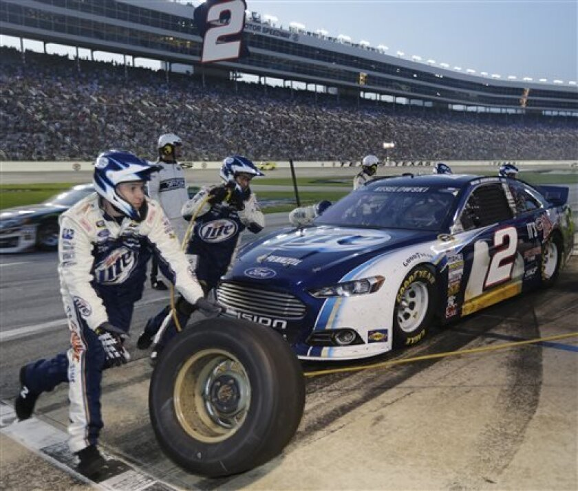 Brad Keselowski (2) has work done at a pit-stop during the NASCAR Sprint Cup series NRA 500 auto race at Texas Motor Speedway, Saturday, April 13, 2013, in Fort Worth, Texas. (AP Photo/Tony Gutierrez)