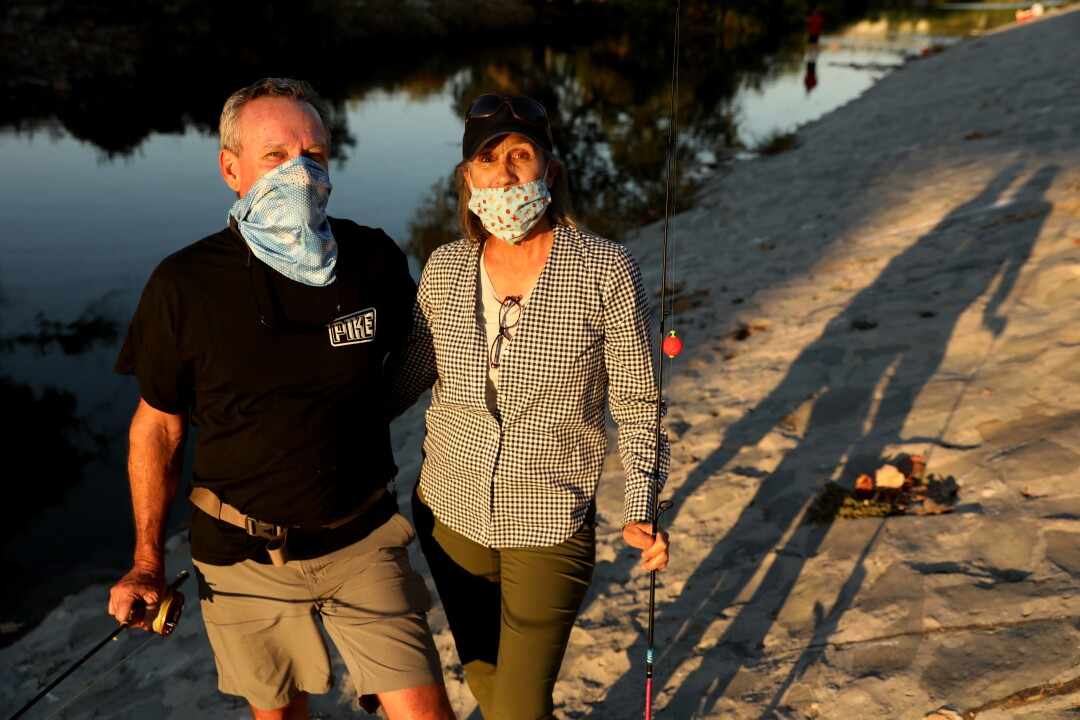 Bob Blankenship and Karen Barnett wear masks on a recent trip to the L.A. River