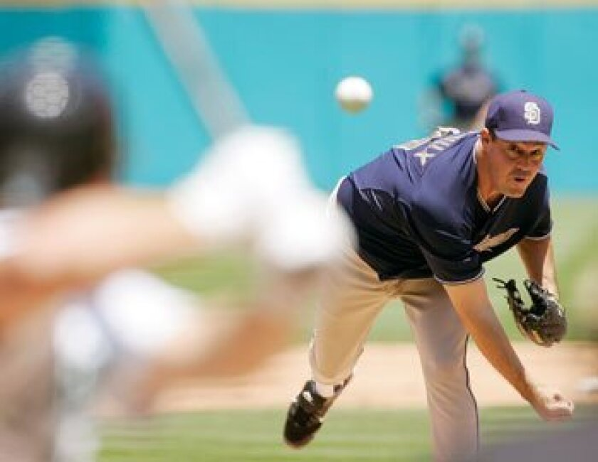 The Padres' Greg Maddux pitches to the Florida Marlins in the third inning Sunday in Miami. AP Photo/J. Pat Carter