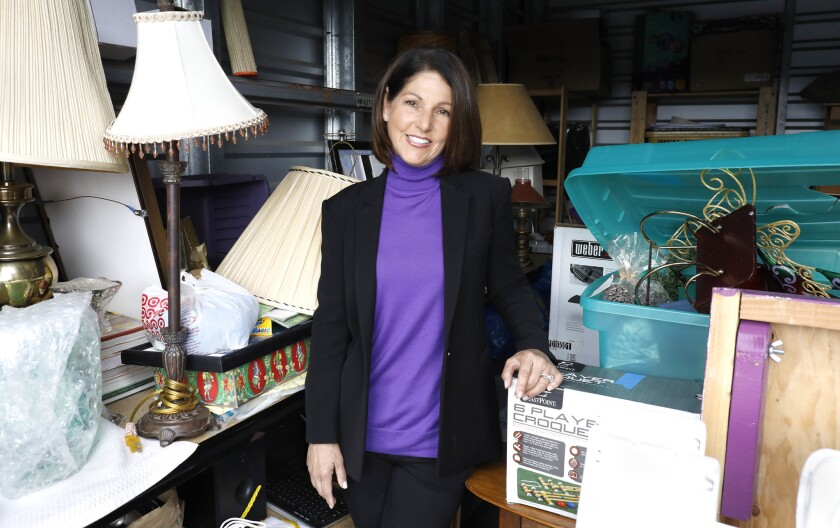 Diane Archambault is a CASA advocate for Voices for Children and a board member and volunteer mentor for Just in Time for Foster Youth.| She was photographed in one of the units where Just In Time stores furniture for its My First Home program.