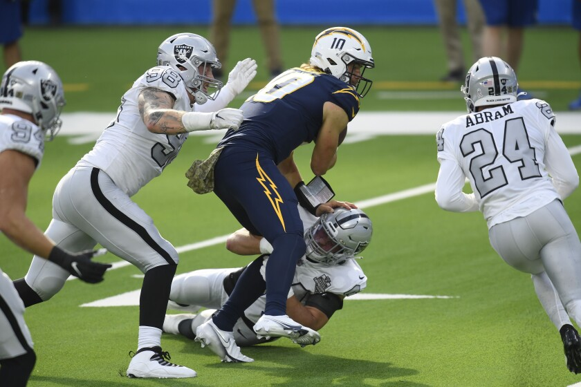 Chargers QB Justin Herbert of the Los Angeles Chargers was under pressure during much of Sunday's game.