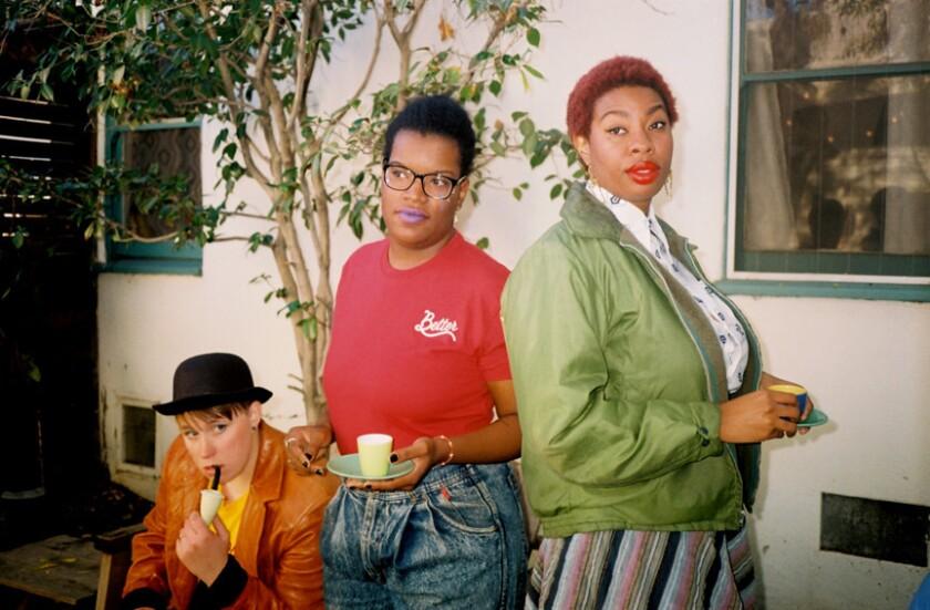Iz, Torri, and Jimanekia wearing custom handpainted jackets by lesbian owned brand, Zoie Loves and n