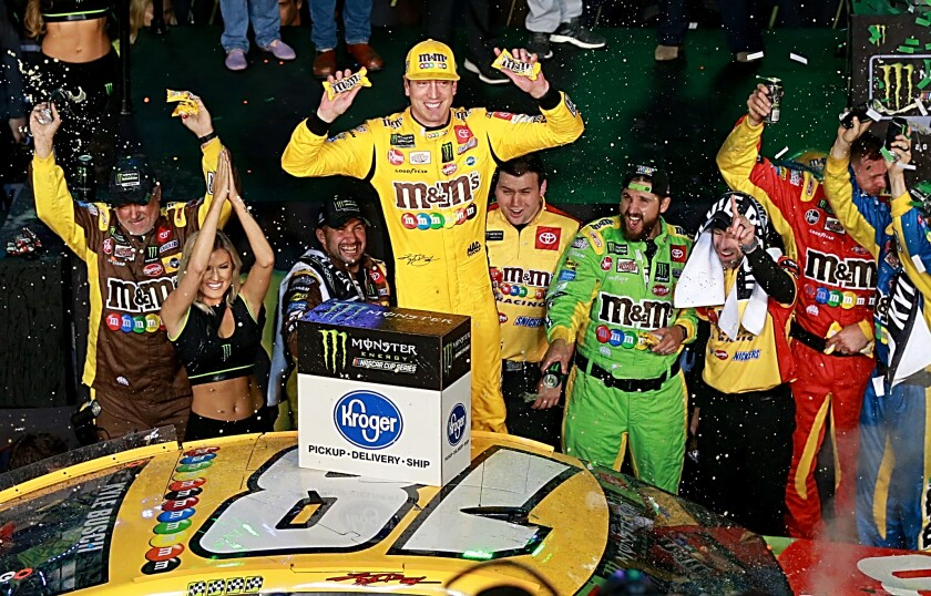 Kyle Busch celebrates after clinching his second NASCAR Cup title Sunday following his win at Homestead Speedway.