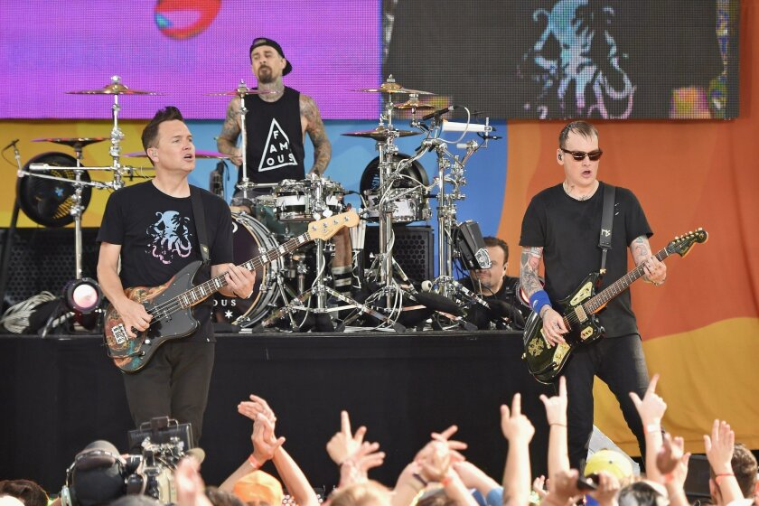 """Mark Hoppus, Travis Barker and Matt Skiba of Blink-182 perform July 1 on ABC's """"Good Morning America"""" at SummerStage at Rumsey Playfield, Central Park."""