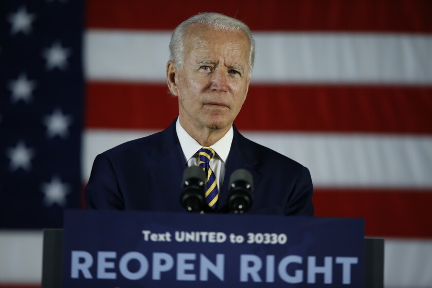 FILE - In this June 17, 2020, file photo Democratic presidential candidate, former Vice President Joe Biden pauses while speaking, in Darby, Pa. Amid a summer of racial unrest and calls for more diversity in leadership, President Donald Trump lags Democratic rival Joe Biden in the percentage of people of color on their campaign staffs, according to data the campaigns provided to The Associated Press. (AP Photo/Matt Slocum, File)
