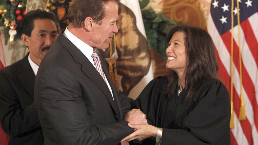 Gov. Arnold Schwarzengger congratulates Tani Cantil-Sakauye after he swore her in as California Supr