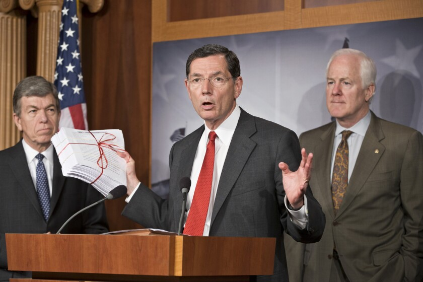 Sen. John Barrasso (R-Wyo.), center, accompanied by Sen. Roy Blunt (R-Mo.), left, and Senate Minority Whip John Cornyn (R-Texas), gestures during a news conference on Capitol Hill about the Affordable Care Act. GOP lawmakers on the Hill have been calling for a delay in the law's requirement that individual Americans carry health insurance.