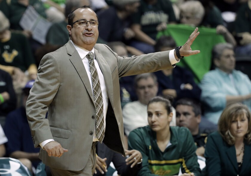 FILE - In this Feb. 27, 2017, file photo, South Florida coach Jose Fernandez calls a play during the first half of the team's NCAA college basketball game against Connecticut in Tampa, Fla. It's been a rough few weeks for Jose Fernandez and his South Florida team. The 14th-ranked Bulls were put on pause because of COVID-19 issues on Jan. 21, 2021 when a Tier I member in the women's basketball program tested positive. They've had other Tier I individuals test positive over the last two weeks, including one on Sunday, Monday and Tuesday. (AP Photo/Chris O'Meara, File)