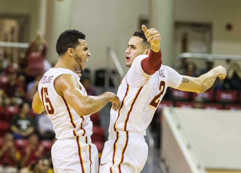 Iowa State's Abdel Nader, right, and Nazareth Mitrou-Long celebrate a three point shot by Nader in the first half of an NCAA college basketball game against Virginia Tech during the Emerald Coast Classic basketball tournament in Niceville, Fla., Friday, Nov. 27, 2015. (AP Photo/Mark Wallheiser)
