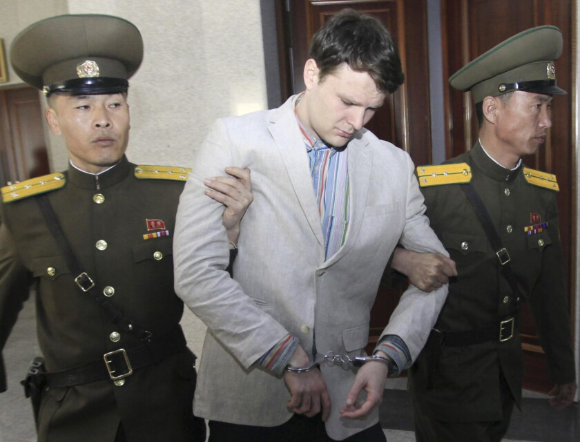 American student Otto Warmbier is escorted by guards into the Supreme Court in Pyongyang, North Korea, on March 16, 2016.