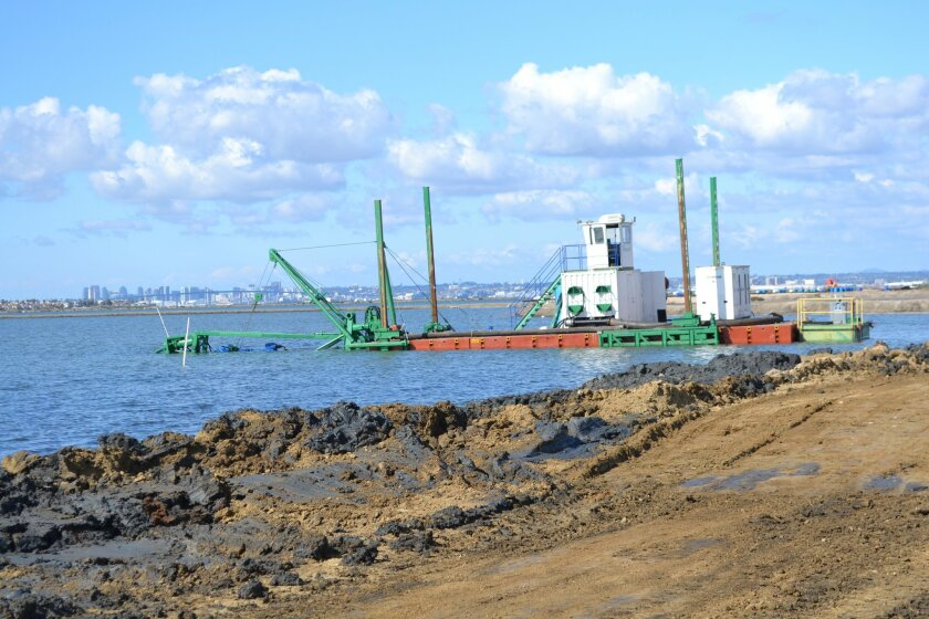 Dredging has begun on a wetland restoration project in the South Bay.
