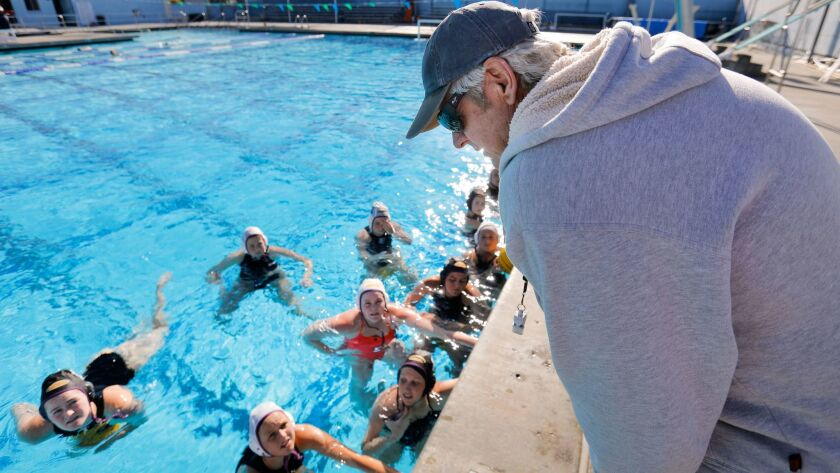 Carlsbad girls water polo coach Greg Horman talks with his team during the season.. The Lancers defeated Cathedral Catholic to win the Open Division title on Saturday.