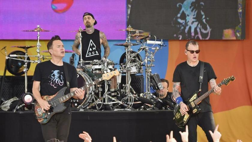 """Mark Hoppus, Travis Barker and Matt Skiba of Blink-182 perform July 1 on ABC's """"Good Morning America"""" at SummerStage at Rumsey Playfield, Central Park. (Mike Coppola)"""
