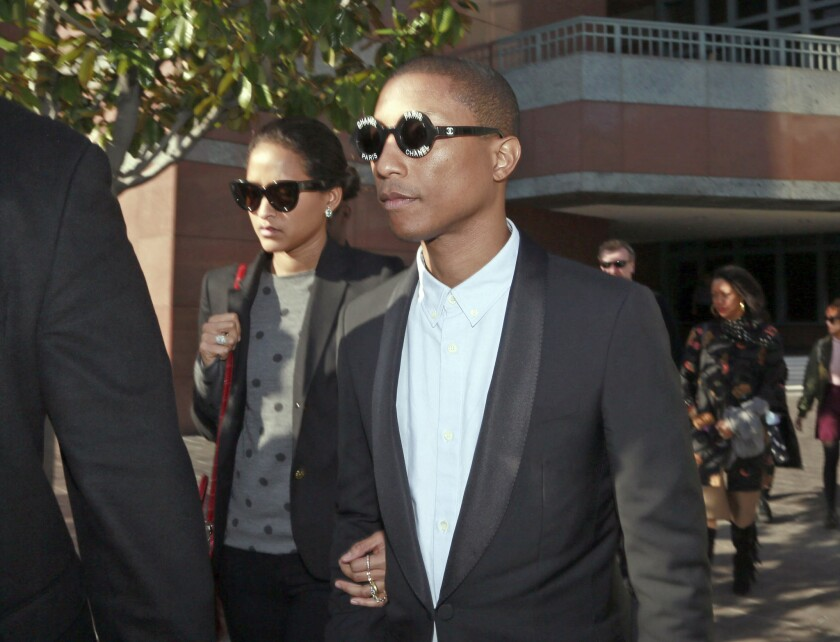 Pharrell Williams leaves the court building after testifying last Wednesday.
