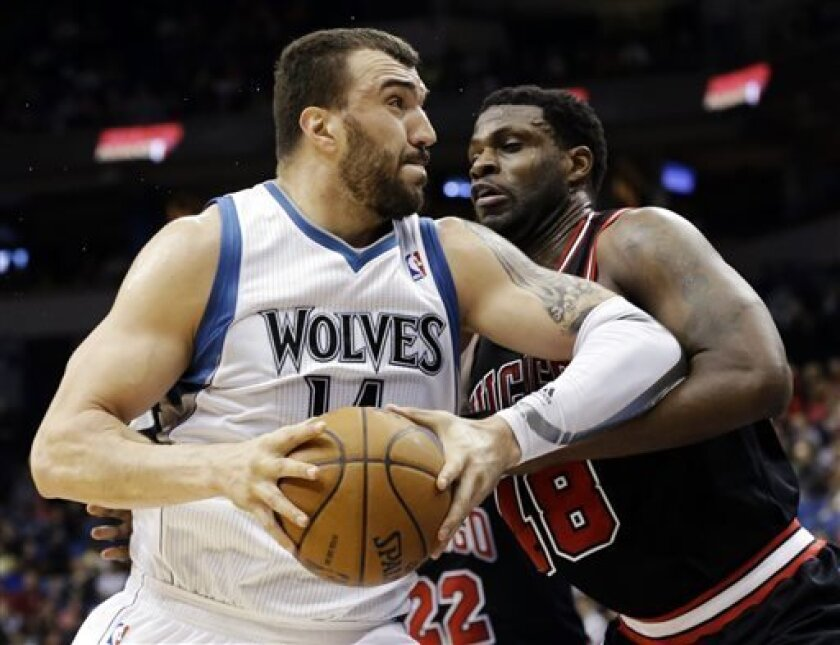 FILE - In this March 24, 2013, file photo, Minnesota Timberwolves' Nikola Pekovic, left, of Montenegro, drives against Chicago Bulls' Nazr Mohammed during an NBA basketball game in Minneapolis. After weeks of negotiations, waiting and watching, Pekovic and the Timberwolves came to agreement on Wednesday, Aug. 14, 2013, on a new five-year contract worth $60 million that includes an additional $8 million in incentives. (AP Photo/Jim Mone, File)
