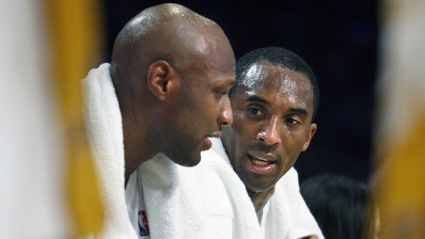 Lakers forward Lamar Odom, left, and guard Kobe Bryant talk on the bench during a timeout against the New Jersey Nets on Nov. 26, 2006.