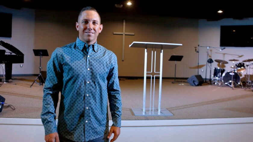 City Light Baptist Church lead pastor Nick Reed, 32 of Burbank, stands at the new facility's main sa