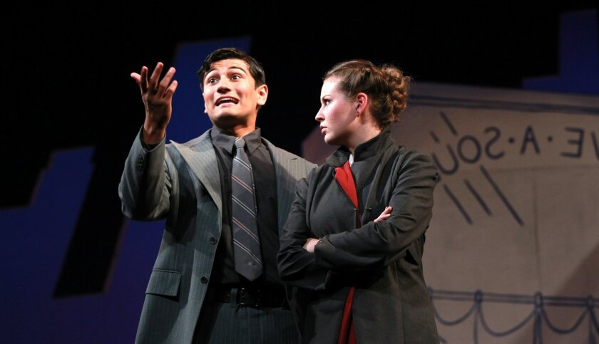 """Isaac Brieske as Sky Masterson and Talia Berkstein as Sarah Brown in a scene from San Diego Junior Theatre's production of """"Guys and Dolls."""""""