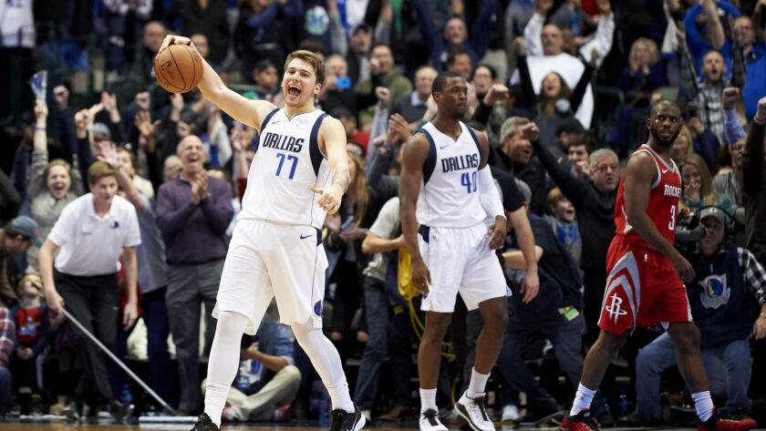 Dallas Mavericks forward Luka Doncic (77) celebrates after the Mavericks defeated the Houston Rocket