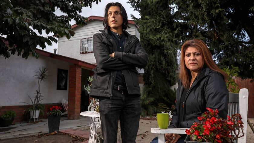 Javier Hernandez Kistte, a 27-year-old DACA recipient, with his mother Vania Kistte, 54, at their home in South L.A.