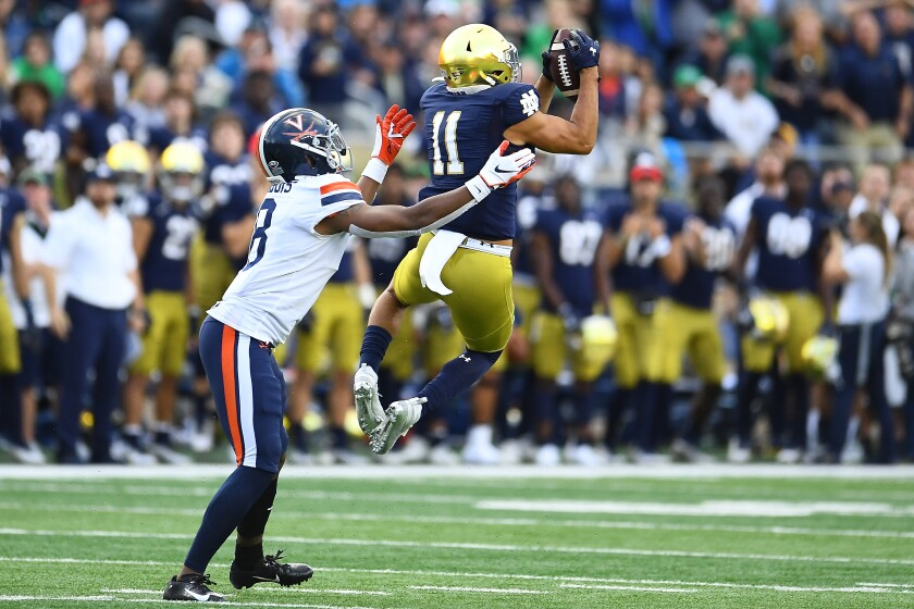 Notre Dame safety Alohi Gilman intercepts a pass against Virginia.