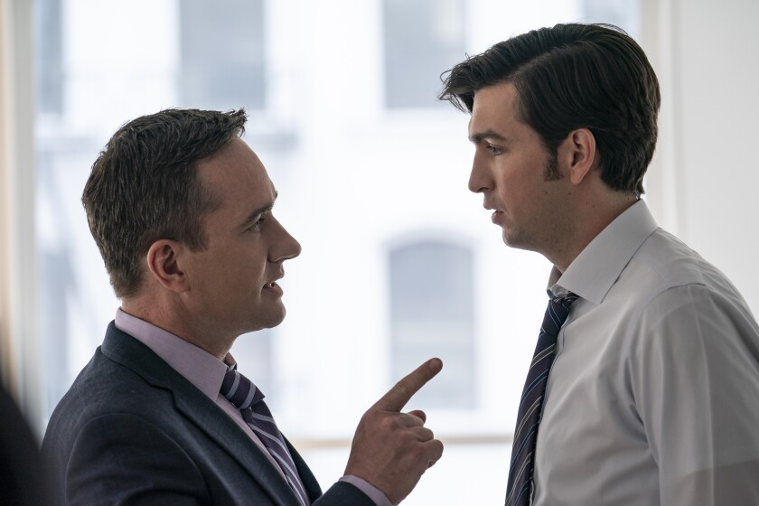 "Matthew Macfadyen, left, stands facing and pointing at Nicholas Braun in HBO's ""Succession."""