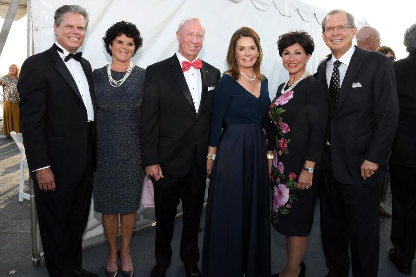 Mac and Nora McLaughlin (he's RAdm. USN Ret.; Midway Museum president/CEO), John and Sarah Hawkins, Annie and David Malcolm